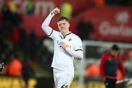 Alfie Mawson of Swansea city celebrates at the end of the game.  Premier league match, Swansea city v Liverpool at the Liberty Stadium in Swansea, South Wales on Monday 22nd January 2018. <br /> pic by  Andrew Orchard, Andrew Orchard sports photography.