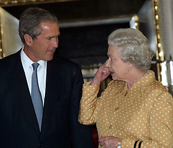 America's President Bush with Britain's Queen Elizabeth II (R) at Buckingham Palace, for lunch.  The US president is on his first visit to the United Kingdom, before travelling on to the G8 summit in Genoa.