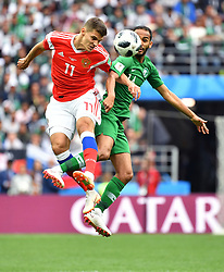 MOSCOW, June 14, 2018  Russia's Roman Zobnin (L) vies with Saudi Arabia's Abdullah Otayf during the opening match of the 2018 FIFA World Cup in Moscow, Russia, on June 14, 2018. (Credit Image: © Liu Dawei/Xinhua via ZUMA Wire)