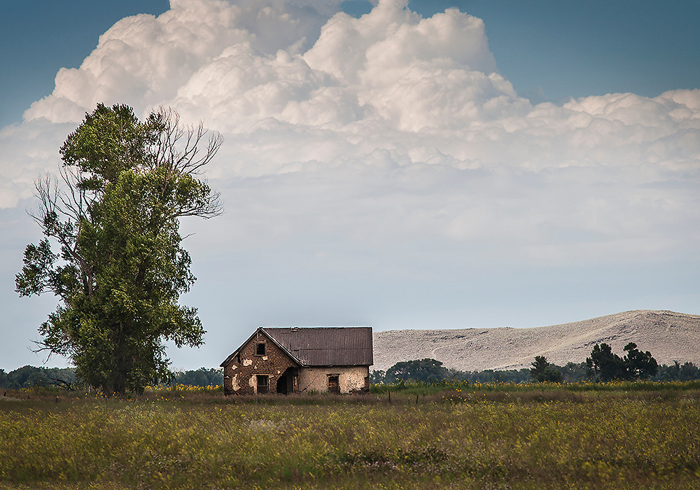 """A fine art photograph of an abandoned house in a field in Colorado's San Luis Valley<br /> <br /> AVAILABLE AS:<br /> <br /> Size 20"""" x 16"""" (50.8cm x 40.6cm approx)*<br /> Edition of ONLY 100 at this size.<br /> US$350 + shipping<br /> <br /> Hand printed in Taos, New Mexico, USA by Taos Print and Photography Services using archival inks and fine art paper. signed and numbered by hand.<br /> <br /> Contact jim@jimodonnellphotography.com to order"""