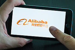 Alibaba Chinese e commerce company logo on an iPhone 6 plus smart phone
