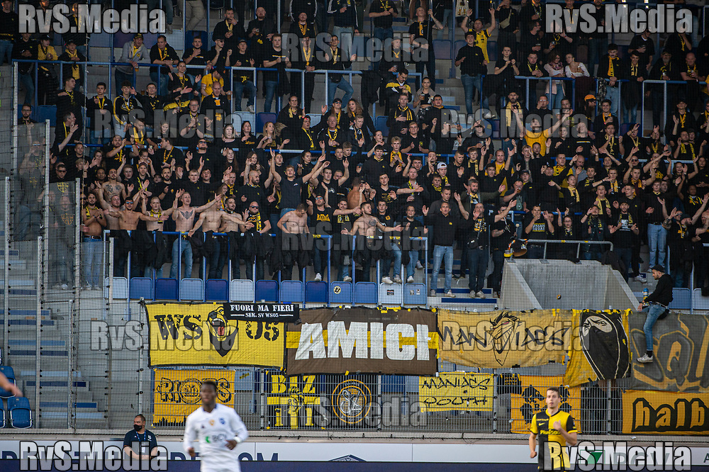 LAUSANNE, SWITZERLAND - SEPTEMBER 22: BSC Young Boys fans cheers during the Swiss Super League match between FC Lausanne-Sport and BSC Young Boys at Stade de la Tuiliere on September 22, 2021 in Lausanne, Switzerland. (Photo by Monika Majer/RvS.Media)