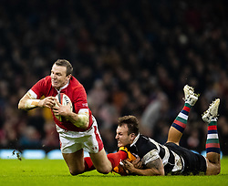 Hadleigh Parkes of Wales is tackled by Andre Esterhuizen of Barbarians <br /> <br /> Photographer Simon King/Replay Images<br /> <br /> Friendly - Wales v Barbarians - Saturday 30th November 2019 - Principality Stadium - Cardiff<br /> <br /> World Copyright © Replay Images . All rights reserved. info@replayimages.co.uk - http://replayimages.co.uk