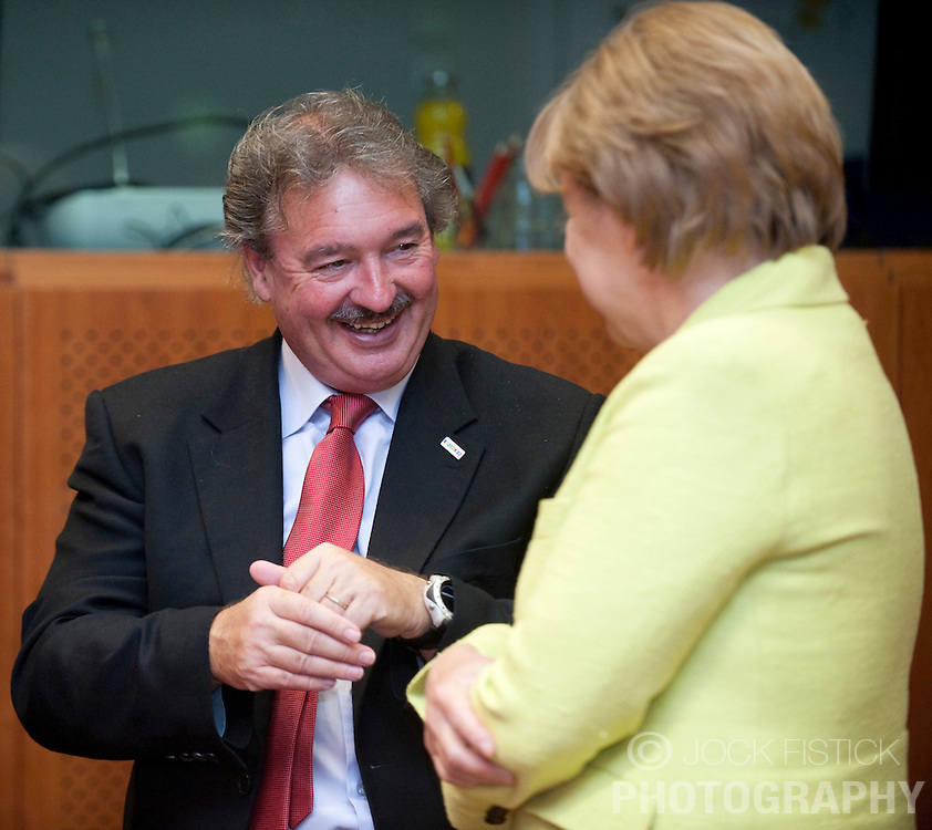 Jean Asselborn, Luxembourg's foreign minister, speaks with .Angela Merkel, Germany's chancellor, during the EU Summit in Brussels, Friday, June 19, 2009. (Photo © Jock Fistick)