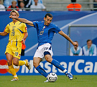 Photo: Glyn Thomas.<br />Italy v Ukraine. Quarter Finals, FIFA World Cup 2006. 30/06/2006.<br /> Italy's Gianluca Zambrotta (R) gives his side an early 1-0 lead.