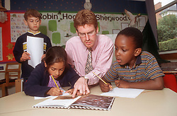 Teacher with multiracial group of primary school children reading in classroom,