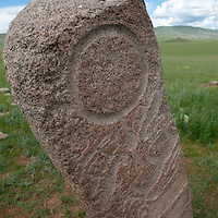 MONGOLIA. 2700+ year-old, bronze age Deer Stone at Ulaan Tolgai site near Lake Erkhel & Muren.  Patterns are probably shamanistic symbols.<br /> <br /> MS0702_060630_0117.NEF
