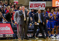 Jan 19, 2019; Morgantown, WV, USA; Kansas Jayhawks head coach Bill Self and coaches celebrate during the first half against the West Virginia Mountaineers at WVU Coliseum. Mandatory Credit: Ben Queen-USA TODAY Sports