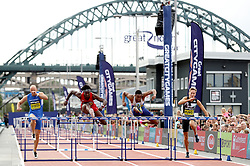 David Omoregie (second left) wins the men's 110 metres hurdles during the Great North City Games at the Newcastle/Gateshead Quayside.