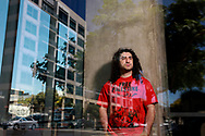 """Ali-Reza Torabi stands in Downtown San Diego, CA on Saturday, Spetember 4, 2021. Torabi was in the sixth grade when two planes slammed into the Twin Towers in New York City on Sept. 11, 2001. Despite living almost 3,000 miles away in San Diego, Torabi saw his world upended.""""As an undocumented, Middle Eastern individual, there was pre-9/11 life and post-9/11 life,"""".(Photo by Sandy Huffaker for The Los Angeles Times)"""