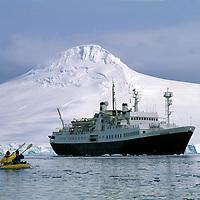 ANTARCTICA. Tourists kakak around passenger ship Endeavor, which lies at anchor near Port Lockroy, off Brabant Island.