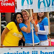NLD/Amsterdam/20100807 - Boten tijdens de Canal Parade 2010 door de Amsterdamse grachten. De jaarlijkse boottocht sluit traditiegetrouw de Gay Pride af. Thema van de botenparade was dit jaar Celebrate, AVRO boot, Christine Braun