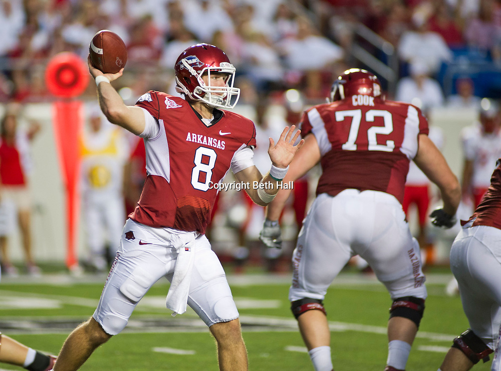 Sep 10, 2011; Little Rock, AR, USA; Arkansas Razorback quarterback Tyler Wilson (8) looks to make a pass during the first half of a game against the New Mexico Lobos at War Memorial Stadium.  Mandatory Credit: Beth Hall-US PRESSWIRE
