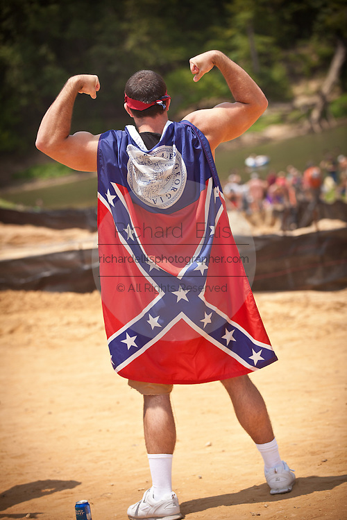 A participant wears a confederate Georgia flag during the annual Summer Redneck Games Dublin, GA.