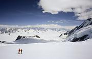 Alaska. Wrangell St Elias NP. 18000 Mt St Elias North Side. Climbers ski to overlook on Bering Glacier and 19000' Mt Logan