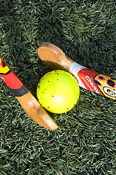 Pair of hockey sticks clashing over a ball during game of hockey,