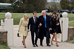 U.S. First Lady Melania Trump, from right, U.S. President Donald Trump, Emmanuel Macron, France's president, and Brigitte Macron, France's first lady, walk after arriving on Marine One at the Mount Vernon estate of first U.S. President George Washington in Mount Vernon, Virginia, U.S., on Monday, April 23, 2018. As Macron arrives for the first state visit of Trump's presidency, the U.S. leader is threatening to upend the global trading system with tariffs on China, maybe Europe too. Photographer: Andrew Harrer/Bloomberg