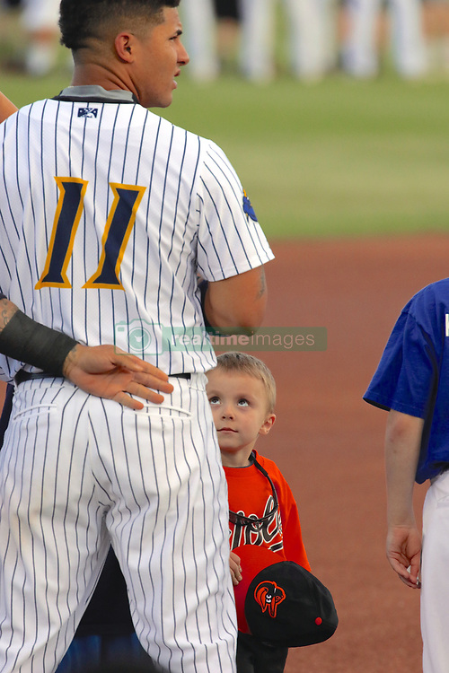 May 2, 2017 - Trenton, New Jersey, U.S - During ''God Bless America'' and the singing of the national anthem before the game vs. the visiting Harrisburg Senators tonight at ARM & HAMMER Park, a few lucky kids get to stand on the baseball field with the players, and this one is standing with #11, GLEYBER TORRES, the New York Yankees' famous top prospect, who currently plays here for the Trenton Thunder. (Credit Image: © Staton Rabin via ZUMA Wire)