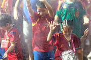 Children celebrating Spain's Euro 2012 championship soccer team arrives to Madrid