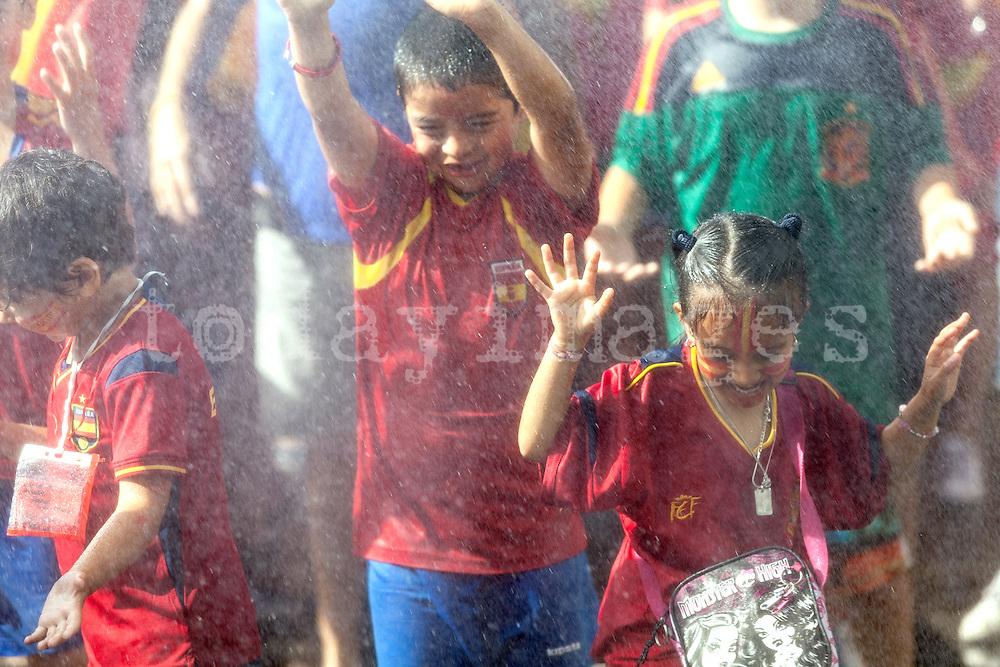 Children celebrating Spain's Euro 2012 championship soccer team arrives to Madrid