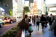 a boy and girl meeting up after work in Shinjuku district in Tokyo