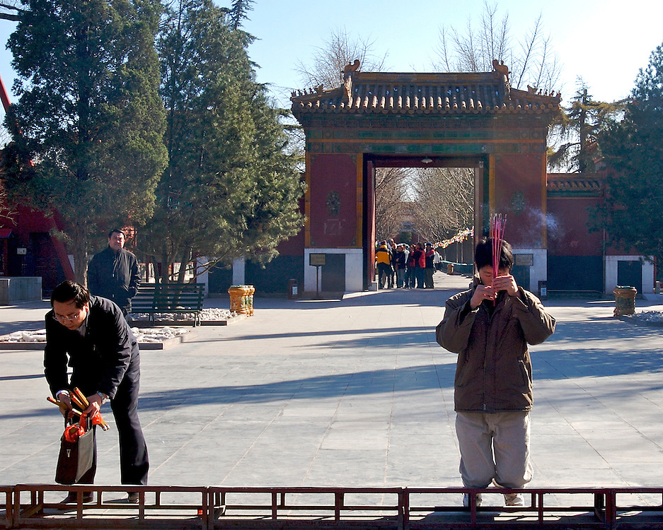 A large bench for praying is set up just inside the inner gate at Yonghegong, a functioning Lama Temple in northern Beijing,China.