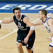 Efes Pilsen's Kerem TUNCERI (L) and Real Madrid's Sergio RODRIGUEZ (R) during their Turkish Airlines Euroleague Basketball Top 16 Group G Game 4 match Efes Pilsen between Real Madrid at Sinan Erdem Arena in Istanbul, Turkey, Thursday, February 17, 2011. Photo by TURKPIX