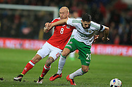 David Cotterill of Wales (l)  challenges Craig Cathcart of Northern Ireland. Wales v Northern Ireland, International football friendly match at the Cardiff City Stadium in Cardiff, South Wales on Thursday 24th March 2016. The teams are preparing for this summer's Euro 2016 tournament.     pic by  Andrew Orchard, Andrew Orchard sports photography.