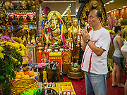 23 DECEMBER 2012 - SINGAPORE, SINGAPORE: People pray and make offerings at a Thai Theravada Buddhist shrine in a shopping mall in Singapore.     PHOTO BY JACK KURTZ