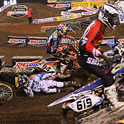 Joshua Hill, Suzuki, comes off his bike and manages to avoid other competitors during the 450SX Class Championship during round 16 of the Monster Energy AMA Supercross series held at MetLife Stadium. 62,217 fans attended the event held for the first time at MetLife Stadium, New Jersey, USA. 26th April 2014. Photo Tim Clayton