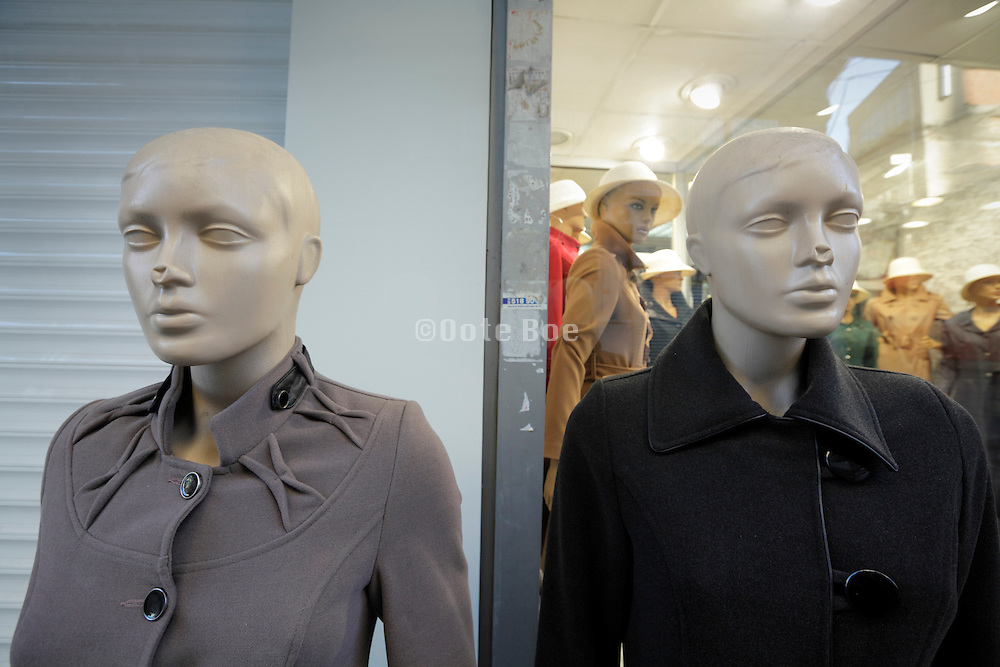 two female doll mannequin both with dented nose