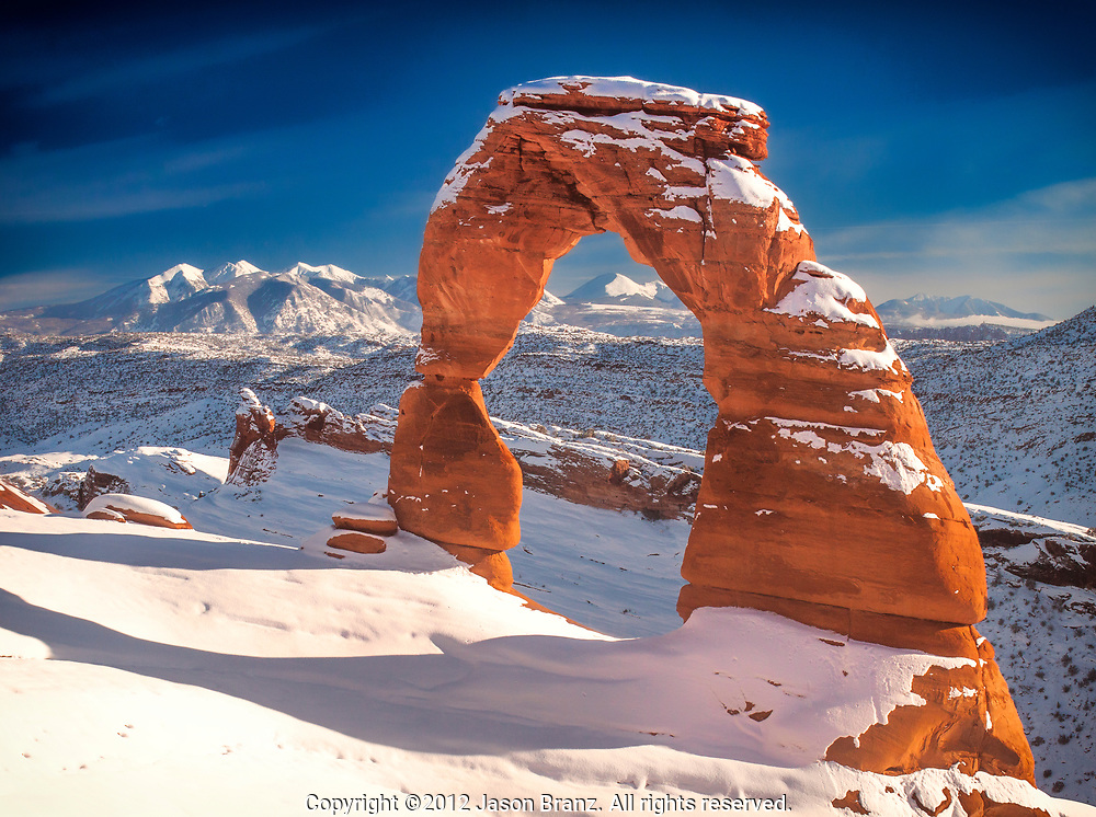 Winter snow on Delicate Arch in Arches National Park, Utah.