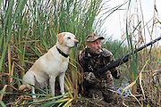 Calling in ducks on a Manitoba duck hunt.