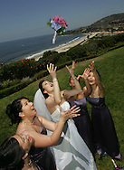"""The former Ms. Tina Tza, from New York poses for photos after her wedding to John Lee at the Ritz-Carlton in Dana Point Saturday June 25, 2005. """"This beautiful location.... you can't ask for a better backdrop,"""" said Lee. """"That's what summer's all about. The beach, the sun. It's everything."""""""