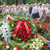 People lay flowers during the funeral of Gyula Horn former prime minister of Hungary in Budapest, Hungary on July 08, 2013. ATTILA VOLGYI