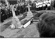 Funeral of Eamon DeValera.   (J72)..1975..02.09.1975..09.02.1975..2nd September 1975..Today saw the funeral of Eamon DeValera. He was laid to rest beside his wife Sinead in Glasnevin Cemetery,Dublin. Dignitries from all around the world attended at the funeral..The president,Cearbhaill O'Dalaigh leads the mourners at the graveside of Eamon DeValera.Members of the religious and political parties are well represented.