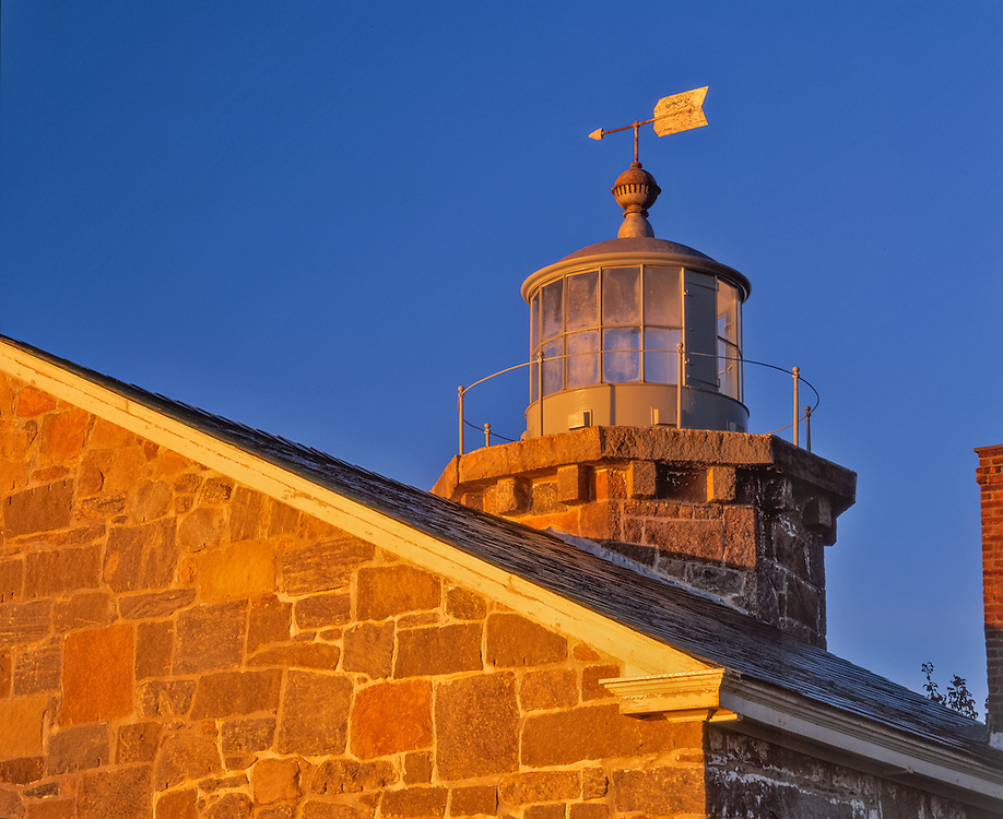 Detail of roofline, old stone lighthouse, now a museum, deep blue sky, Stonington, CT