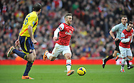 Arsenal's Jack Wilshere makes a break during Barclays Premier League , Arsenal v Sunderland at the Emirates Stadium in London, England on Saturday 22nd Feb 2014.<br /> pic by John Fletcher, Andrew Orchard sports photography.