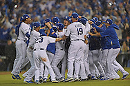 Oct 5, 2014; Kansas City, MO, USA; The Kansas City Royals celebrates after beating the Los Angeles Angels during game three of the 2014 ALDS baseball playoff game and advancing to the ALCS at Kauffman Stadium. Mandatory Credit: Peter G. Aiken-USA TODAY Sports