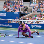 2019 US Open Tennis Tournament- Day Seven.  Serena Williams of the United States rills her ankle and falls over during her match against Petra Martic of Croatia in the Women's Singles round four match on Arthur Ashe Stadium during the 2019 US Open Tennis Tournament at the USTA Billie Jean King National Tennis Center on September 1st, 2019 in Flushing, Queens, New York City.  (Photo by Tim Clayton/Corbis via Getty Images)