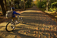 A 9 year-old boy rides his bike though Acadia National Park.
