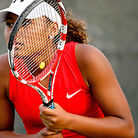 050813  Adron Gardner/Independent<br /> <br /> Grants Pirate Paris Corley is seen throughout the lattice of her tennis racquet during the tennis state tournament in Albuquerque Wednesday.