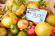 Fresh pomegranate fruit, melograne, on sale at weekly street market in Panzano-in-Chianti, Tuscany, Italy