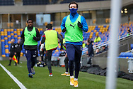 AFC Wimbledon defender Luke O'Neill (2) and AFC Wimbledon attacker Zach Robinson (14) warming up as sub during the EFL Sky Bet League 1 match between AFC Wimbledon and Sunderland at Plough Lane, London, United Kingdom on 16 January 2021.