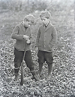 Boys loading BB gun early 1900's