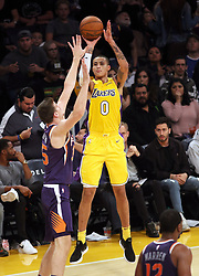 November 17, 2017 - Los Angeles, California, U.S - Lakers Kyle Kuzma puts up this jumper under duress from  Suns defender Dragan Bender during the contest as the  host Los Angeles Lakers fall to the visiting Phoenix Suns  122-113 on Friday, November 17, 2017 at the Staples Center  in Los Angeles, California. (Credit Image: © Prensa Internacional via ZUMA Wire)