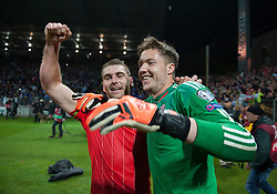 ZENICA, BOSNIA & HERZEGOVINA - Saturday, October 10, 2015: Wales goalkeeper Wayne Hennessey and Sam Vokes celebrate after securing a place at next years Euro Championships after the Bosnia & Herzegovina vs Wales match at the Stadion Bilino Polje during the UEFA Euro 2016 qualifying Group B match. (Pic by Peter Powell/Propaganda)