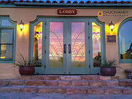 Sunset reflects in the doorway to the Furnace Creek Inn in Death Valey National Park, California, USA