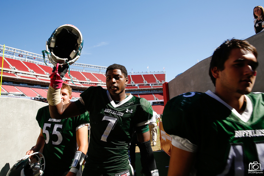 Manteca running back Darrion Kitson (7) holds his helmet high as the Buffaloes leave the field after losing to Oakdale 42-21 during Friday Night Lights at Levi's Stadium in Santa Clara, California, on October 11, 2014. (Stan Olszewski/ Special to The Record)