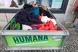 Secondhand clothes for ale at Humana shop in Berlin, Germany